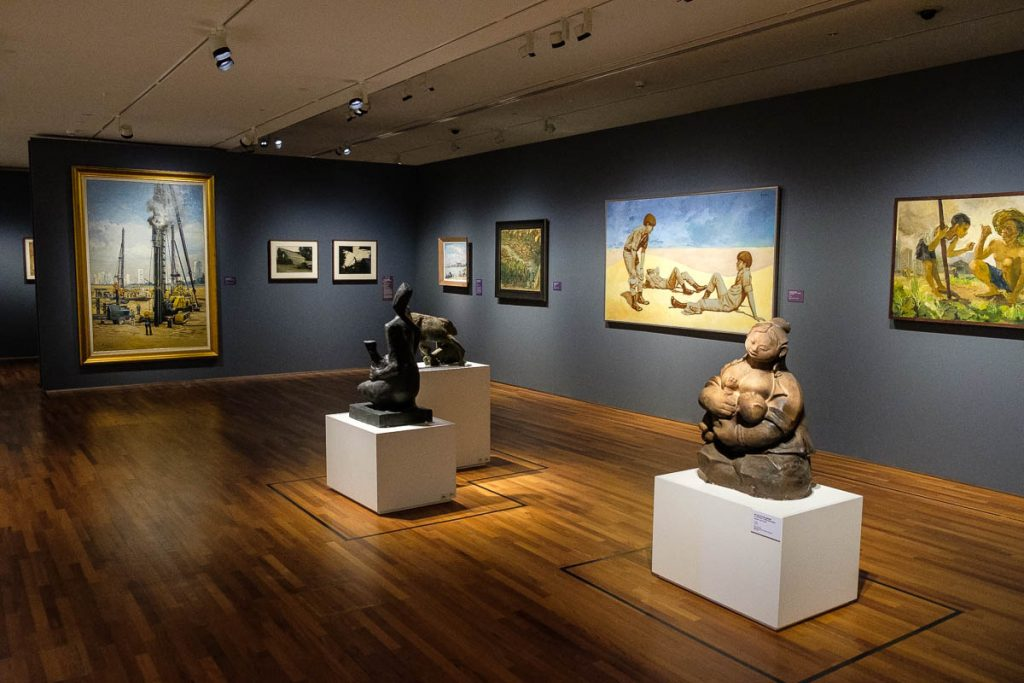 Various pieces of artwork on display at Singapore's National Gallery.