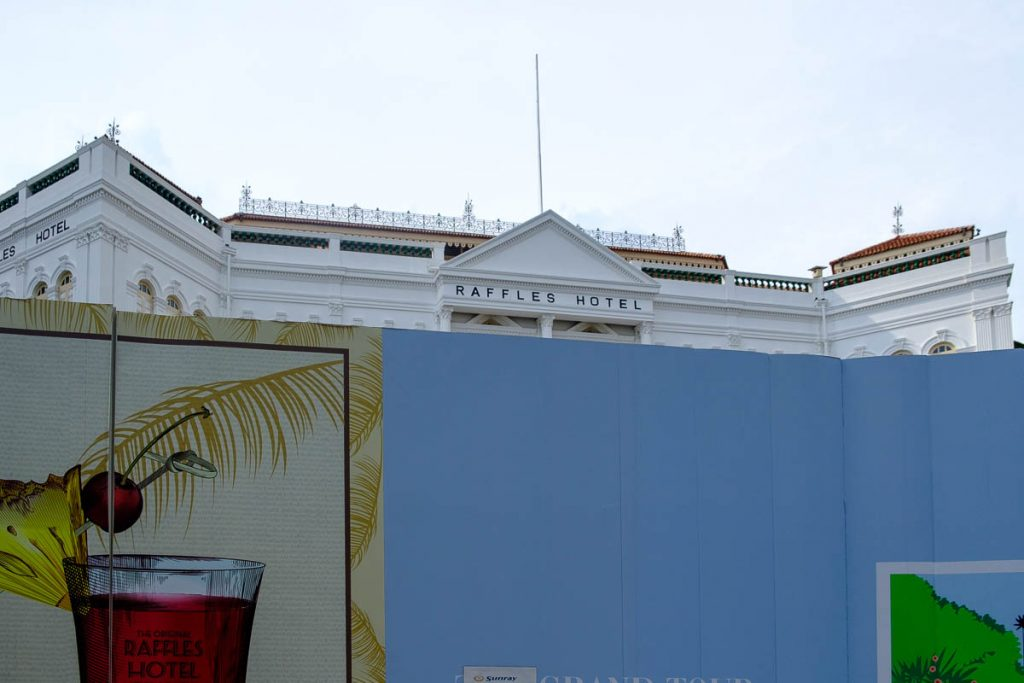 Photo of Raffles Hotel behind barrier during renovation.