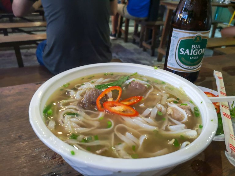 Bowl of Pho and Bia Saigon at the Ben Thanh Street Food Market