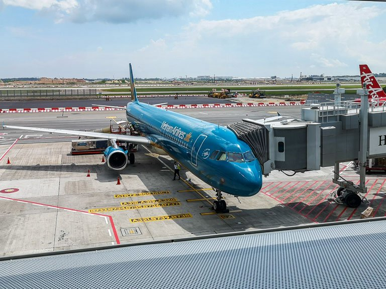 Photo at Vietnam Airlines Jet waiting at the Jetway at Changi Airport in Singapore.