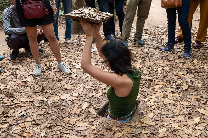 Girl entering Cu Chi Tunnels