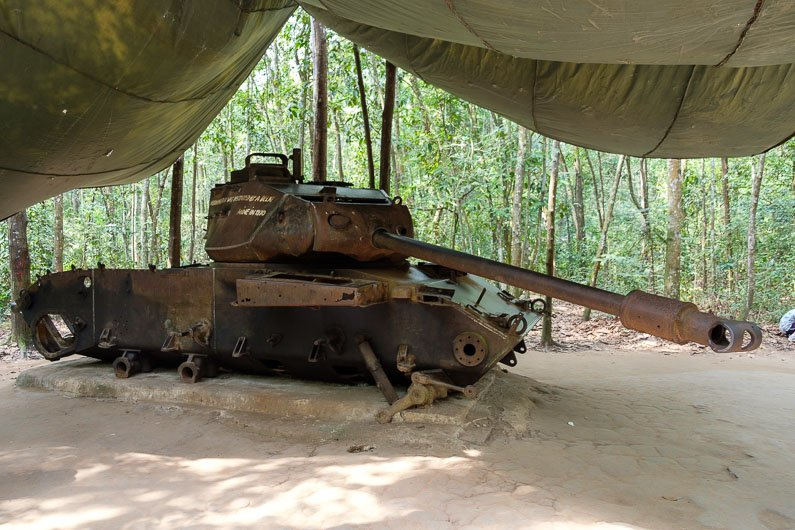 Destroyed American tank at the Cu Chi Tunnels tourist park in Vietnam
