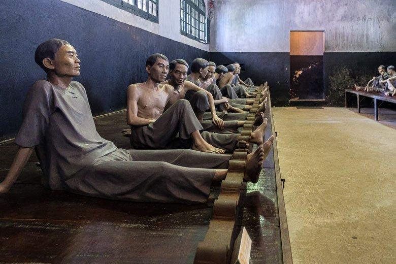 Prisoners in shackles at Hanoi Hilton in Hanoi, Vietnam.  Hoa Lo Prison.