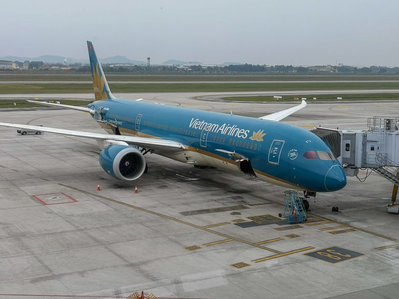 Photo of Vietnam Airlines plane at the gate at Noi Bai International Airport in Hanoi.
